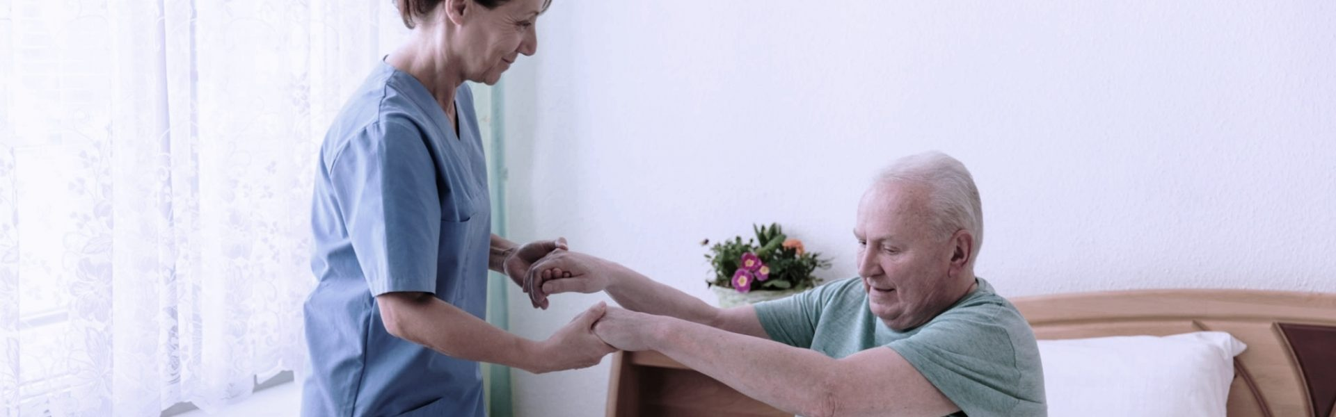 Female caregiver helping senior man